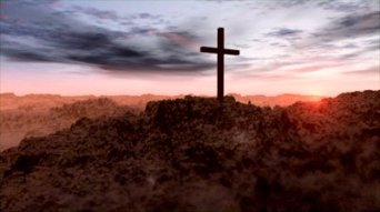stock-footage-pan-of-cross-in-desert-landscape-at-sunrise